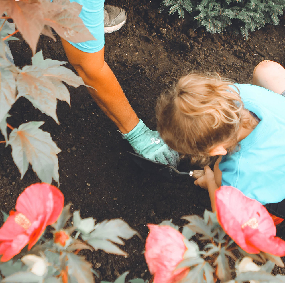 girl digging in the garden